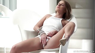 Sofi Goldfinger masturbates on the armchair using her long fingers